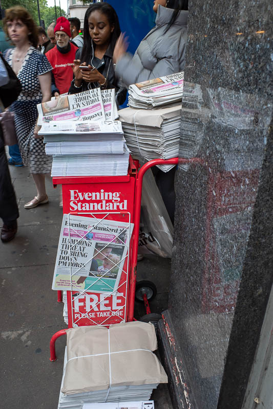 England-London-Chinatown - They still give out these free horrifically bad for the environment advertising newspapers at every train station in London.
