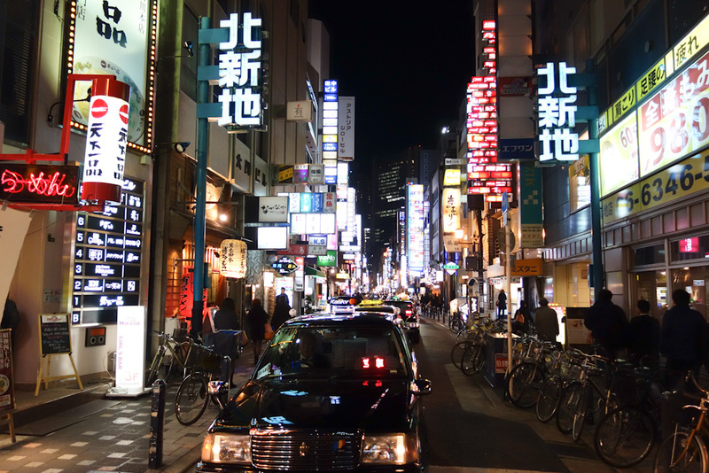 Japan-Osaka-Dotonbori - Back near Umeda now, and this street is particularly full of neon. A sign said it was something to do with a twin suicide of princesses in 1700. Today