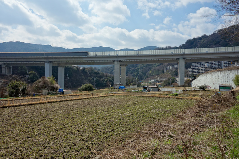 Japan-Osaka-Namaze-Hiking-Tunnel - I found my turnoff which took me through someones farming land. I think this viaduct thing is a shinkansen line.