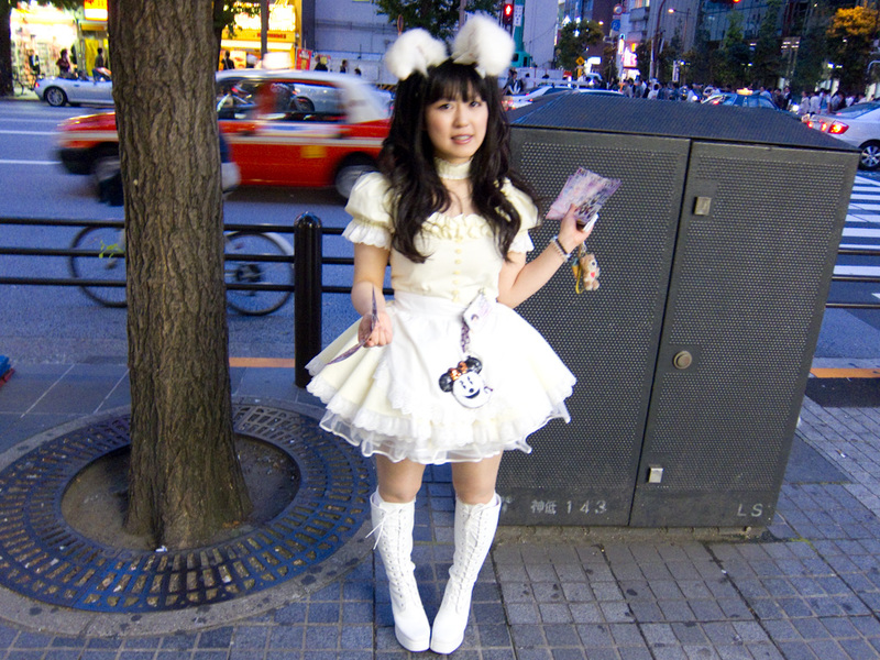 Japan-Tokyo-Ginza-Akihabara - Another maid, but note how she is standing. I have noticed that many Japanese girls walk like this, like they are almost crippled. Why is this? Guys d
