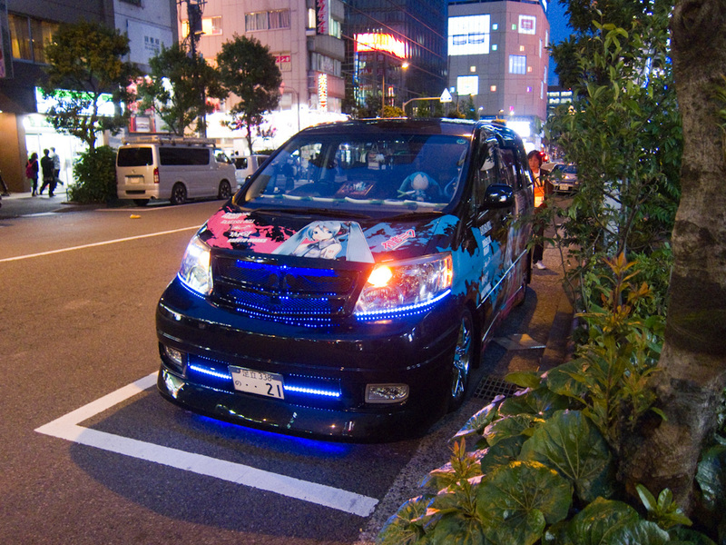 Japan-Tokyo-Ginza-Akihabara - There are many cars painted in a tribute to various manga type things. Vans are the most popular to paint like this, just like the USA do with crappy