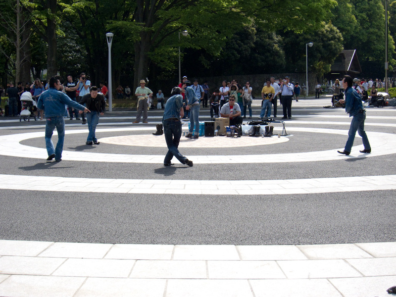 Japan-Tokyo-Imperial Palace-Harajuku-Yoyogi Park - Rockabilly dancers. This I dont get. The dancing is nothing clever or special, the guys are old and sweaty. Yet they turn up every week and draw a cro
