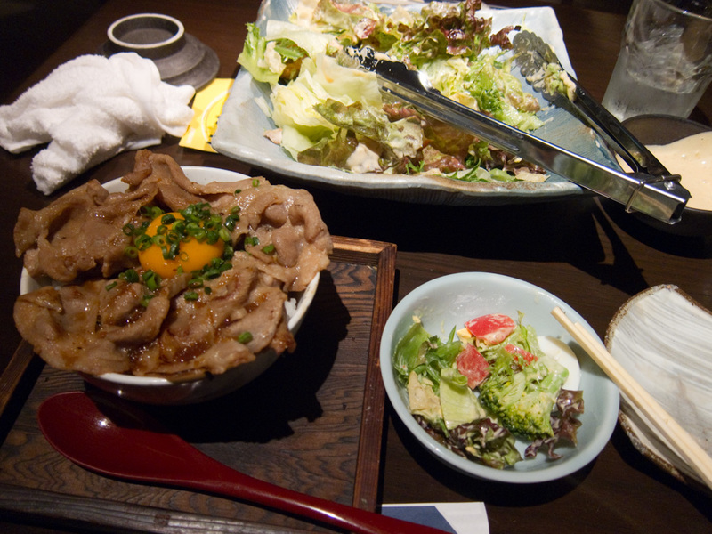 Japan-Tokyo-Shinjuku - I also got a pork bowl, which came with the standard raw egg cracked on the top. Under the pork is rice. I ate all the salad which was pretty deliciou