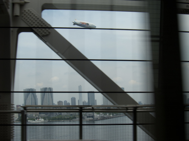 Japan-Tokyo-Odaiba-Shibuya - Im rinding on a monorail, going over the rainbow bridge, and watching a blimp fly past. Yes I was quite excited.