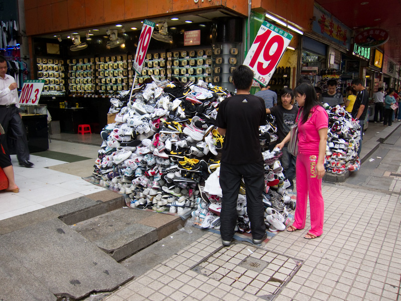 China-Shenzhen-Architecture - In the Dongman district, theres piles of anything you could want to buy, shoes like in this photo, but also clothes, handbags, socks, umbrellas, kids