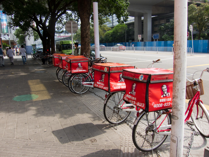 China-Shenzhen-Architecture - KFC is popular, and sells tacos, beef tacos. They also have bike delivery men. I am not sure if they are samurais or not.
