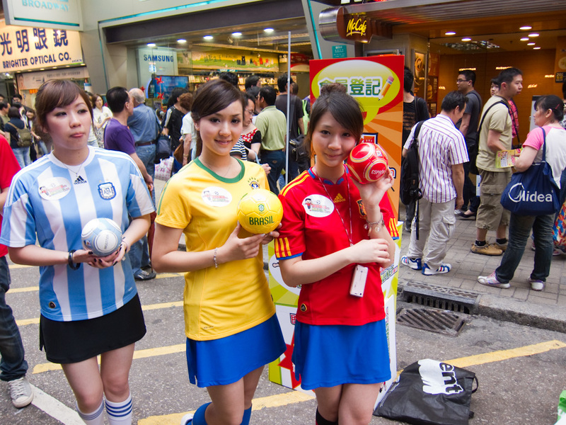 Hong Kong-Mong Kok - Time for some Hong Kong promotions girls, they are very popular amongst the throngs of photographers, these ones advertising the world cup.