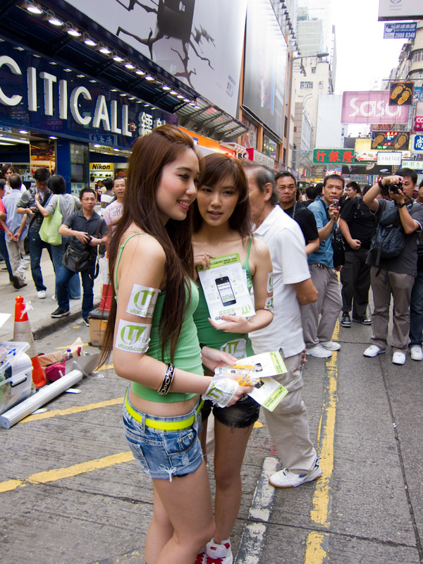Hong Kong-Mong Kok - Not sure what these ones are advertising, but there was a hierachy of girls, some in full green business attire, some in shorts and regular tshirts, a