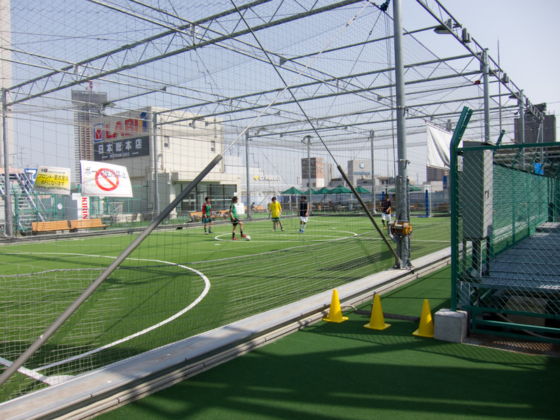Japan-Tokyo-Ginza-Ikebukuro - On the roof of a 12 storey electronics shop (top 2 floors were restaurants), is 5 a side soccer. I had no idea, I just kept going up the stairs and en