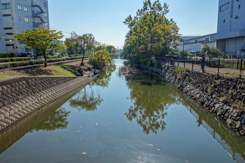 Japan-Tokyo-Mall-Koshigaya-Aeon Lake - One of the open drains in the industrial area, except theres guys fishing down there. The water is very shiny! I hope they arent planning to eat anyth