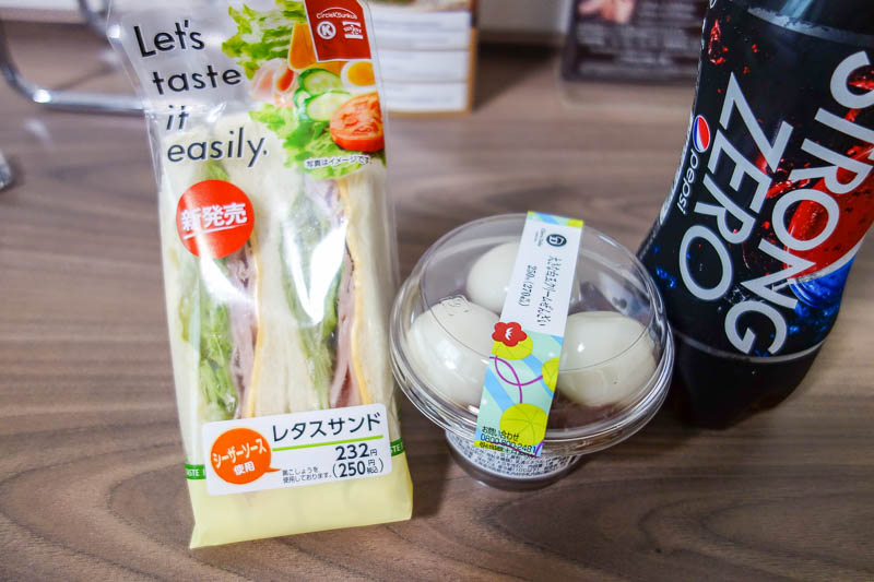 Japan-Tokyo-Nagoya-Shinkansen - I was super hungry by now, so it was time for a $2.50 convenience store sandwich (crusts removed of course), with a mochi and sweet bean dessert, abso