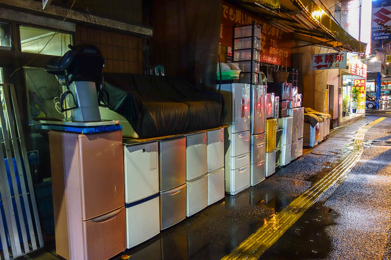 Japan-Hiroshima-Food-Mapo Tofu-Rain - On the wrong side of the tracks, I was able to appreciate that a whitegoods store just leaves their product un guarded on the street all night.