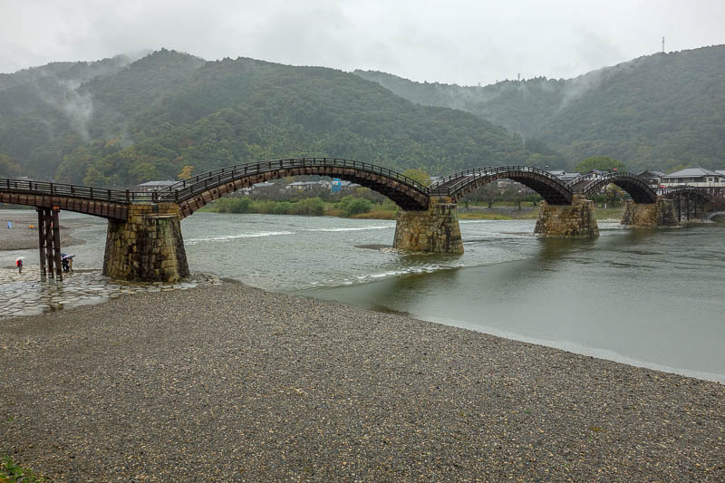 Japan-Iwakuni-Bridge-Rain-Hiking - And heres the bridge. Its been reconstruted recently. Originally it was all wood but kept washing away. Also in the times before tourism, only Samurai