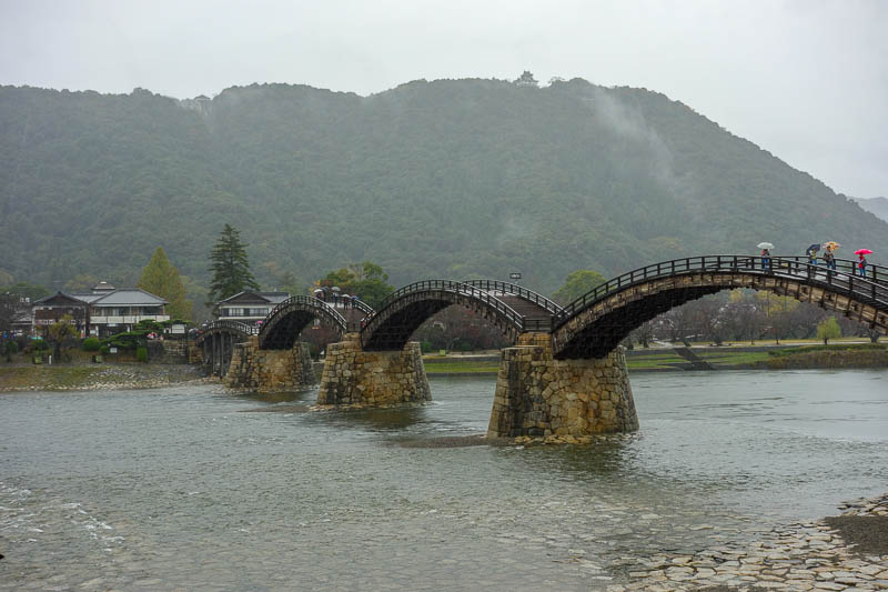 Japan-Iwakuni-Bridge-Rain-Hiking - You can just see the castle on the top of the hill behind the bridge.