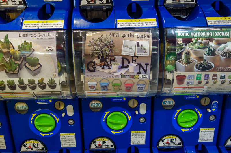 Japan-Hiroshima-Rain-Food-Pho - We have a few places in Adelaide with the capsule machines where you put money in and get a prize, normally a Pokemon. Japan you can get a whole cactu