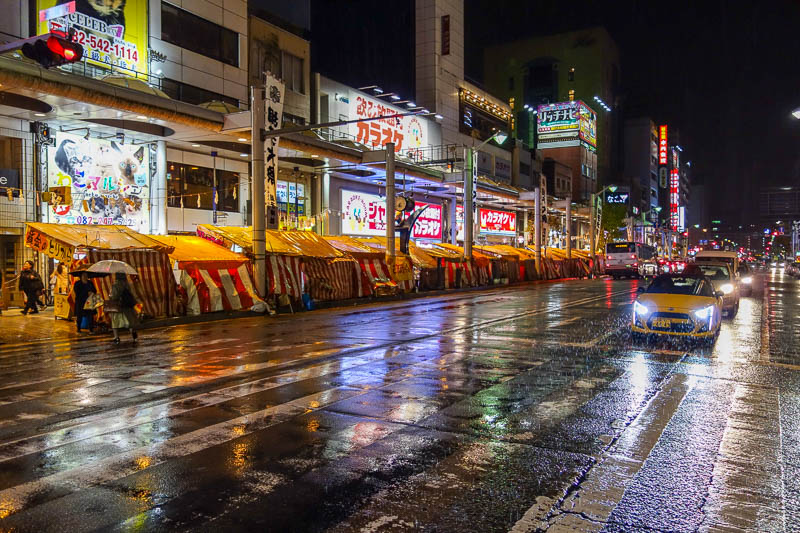 Japan-Hiroshima-Rain-Food-Pho - But then I noticed both sides of every street for many blocks had similar things set up, on a Wednesday night.