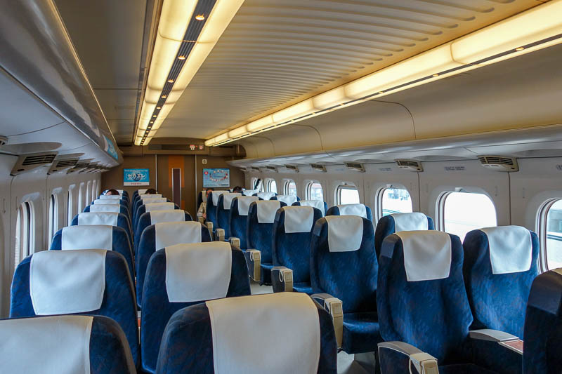 Japan-Hiroshima-Shimonoseki-Shinkansen - Todays bullet train was a different kind. Seating is 2 x 2 not 2 x 3, and its also empty apart from me.