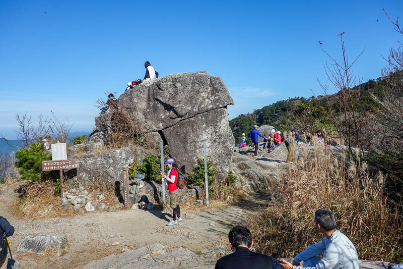 Japan-Fukuoka-Hiking-Mount Homan-Dazaifu - There are lots of people hanging around having a picnic.