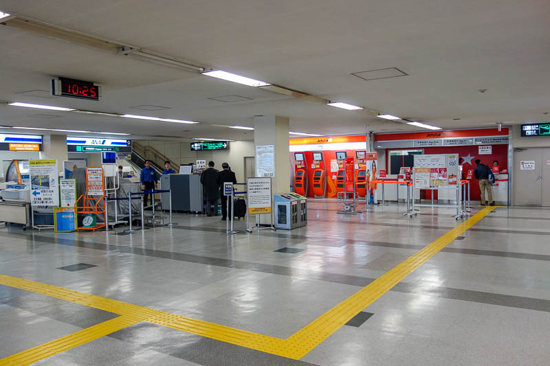 Japan-Fukuoka-Tokyo-Airport - The Jetstar check in area, just 2 counters. They wouldnt let me check in until 2 hours before my flight. Yes I was early. So I had to wheel my bag aro