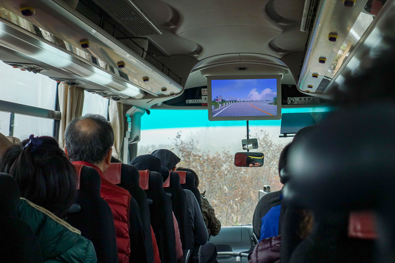 Japan-Tateyama-Kurobe-Alpine-Hiking - The bus operator has done a Chinese observation deck trick. Because the view out the window is so often fog and cloud, they filmed a clear day, and pl