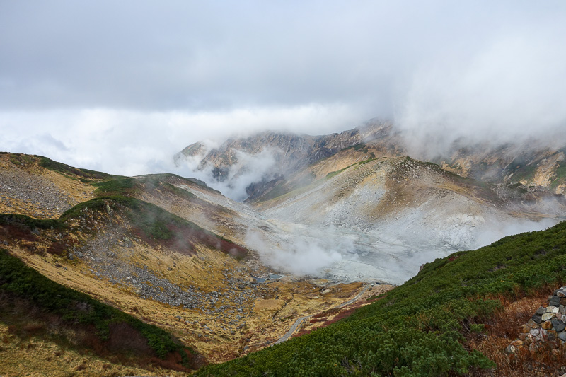 Japan-Tateyama-Kurobe-Alpine-Hiking - Optical illusion, thats looking down at cloud, but theres also steam and gas coming out of the ground.