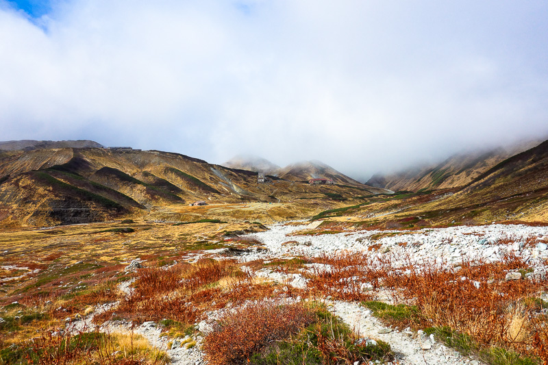 Japan-Tateyama-Kurobe-Alpine-Hiking - Looking downwards at hell valley and some abandoned lodges.