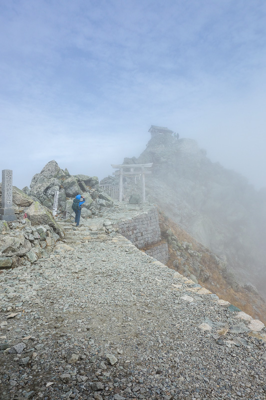 Japan-Tateyama-Kurobe-Alpine-Hiking - This is the path to the summit shrine, the light gives it an end of the world aura.
