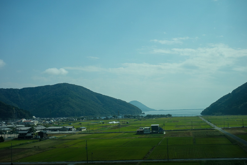 Japan-Kanazawa-Kyoto-Train - Heres the lake, a tiny bit of it. The lake is enormous, looks like the ocean, except for the vast majority of the journey you cant see it due to smog!