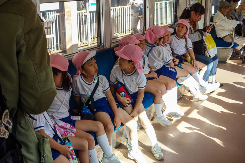 Japan-Kyoto-Hiking-Mount Hiei - I took a photo of school kids. This is the pink hat gang. There was also a yellow hat gang. Along with their hats they all have a drink bottle slung o