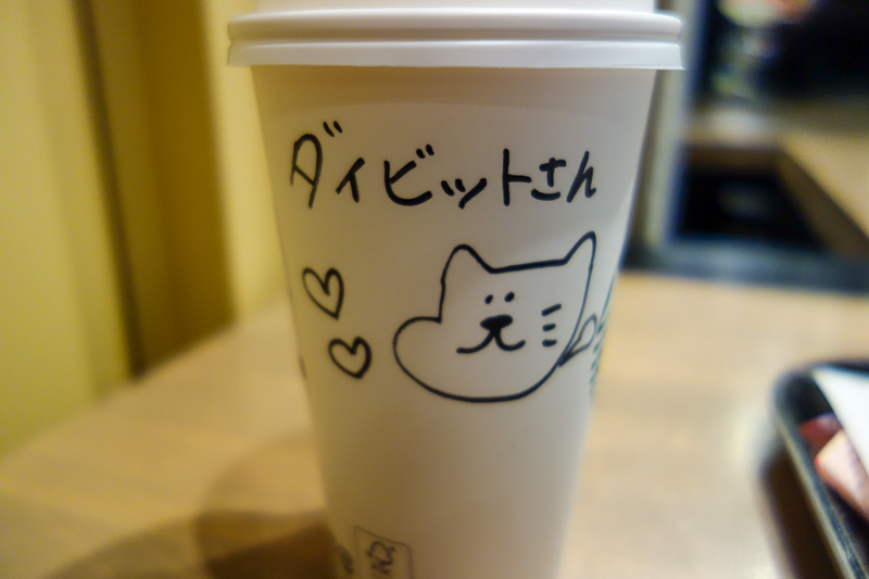 Japan-Osaka-Sapporo-Kansai-Chitose - My regular morning coffee at Starbucks was differnt today in Kyoto, I got a picture and a message. I have no idea what it says, but the cat she drew s
