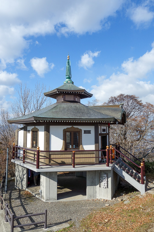 Japan-Sapporo-Hiking-Mount Moiwa - And now I am at the summit. Heres the temple. Theres also a 3 storey restaurant, tv towers, bus parking and the ropeway station.