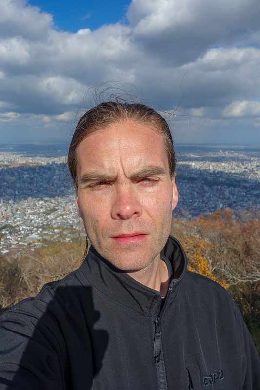 Japan-Sapporo-Hiking-Mount Moiwa - Do I look cold? The glare was ridiculous, I couldnt open my eyes for the selfie.