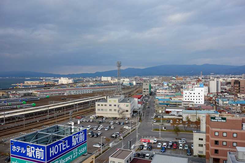 Japan-Sapporo-Hakodate-Train - I can keep a close eye on the trains coming and going, and the mountains in the distance.