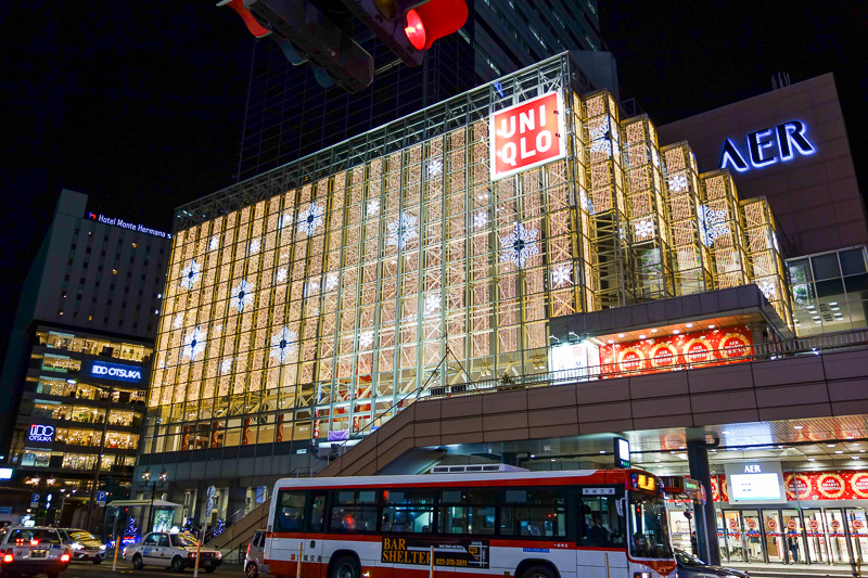 Japan-Sendai-Shopping Street - Uniqlo has their christmas lights in full beaming lightness already.