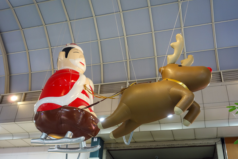 Japan-Sendai-Food-Mapo Tofu - Japanese santa. Someone has replaced a fat white man with a fat Japanese man. Cultural misappropriation.