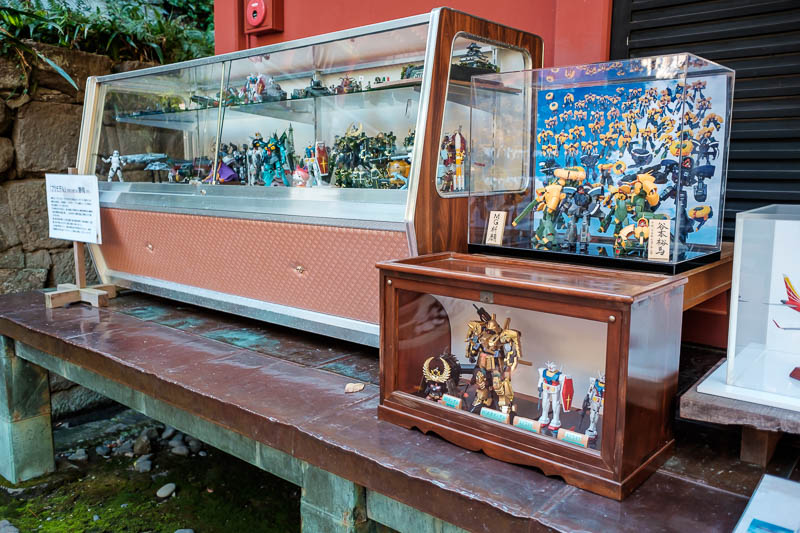 Japan-Shizuoka-Shrine-Kunozan Toshogu-Hiking - I suspect the children were very excited to see this. For whatever reason this temple has a heap of model toys on display, receiving a blessing from t