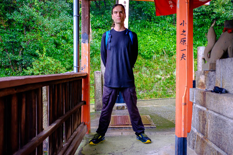 Japan-Kyoto-Fushimi Inari-Shrine-Rain - THE STANCE. I still dont look as wet as I was. Although the weight of water on my long sleeve t-shirt (appropriate rain attire?) really shows off my m