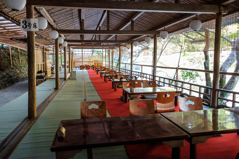 Japan-Kyoto-Hiking-Mount Atago-Arashiyama - Instead of the trail, its a big open air restaurant. There is without exaggeration about 100 metres of seating like this along the cliff.