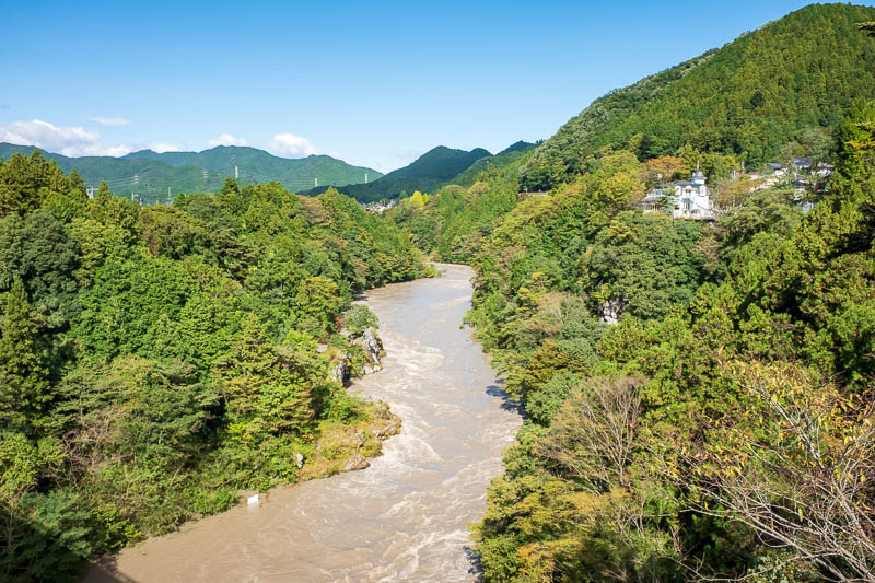 Japan-Ome-Hiking-Garden - Here is what typhoon rain in a river looks like. Dangerous. Apparently a handful of people died in floods, probably like Australia trying to drive acr