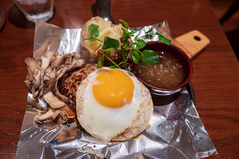 Japan-Osaka-Umeda-Mall-Food - And finally, my dinner, which is a hamburger steak on top of a couple of vegetables, with Japanese style mystery sauce, an egg, mushrooms and a baked