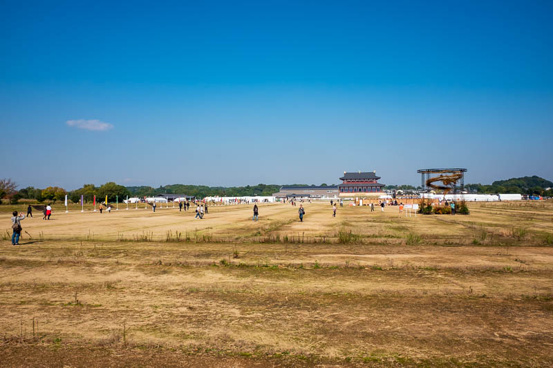 Japan-Nara-Hiking-Deer - This huge open field is for now, the castle ruins, theres nothing to see here really. But theres lots of people and a couple of different fairs going
