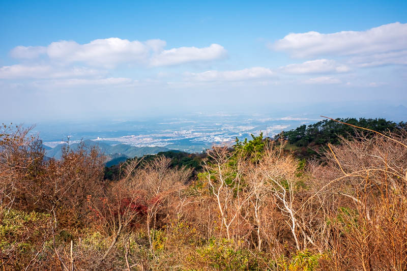 Japan-Kobe-Hiking-Mount Rokko - The far side of the mountain is more cities. Nishinomiya apparently. Never heard of it. A guy taking the same photo pointed and said that to me, I che