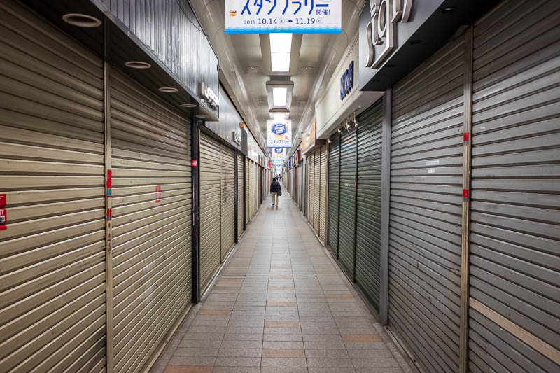 Japan-Kobe-Gifu-China Town-Shinkansen - The last bit of my walk, between the tracks, miles and miles of closed garage doors. I dont know how many of them still have shops behind them or if t