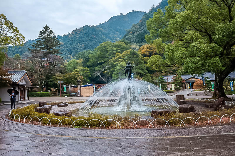 Japan-Gifu-Rain-Fog-Castle-Garden - Now I am at the city park, and if you squint through the fog, you can see the castle on top of the hill. There is an art gallery here with a Michaelan