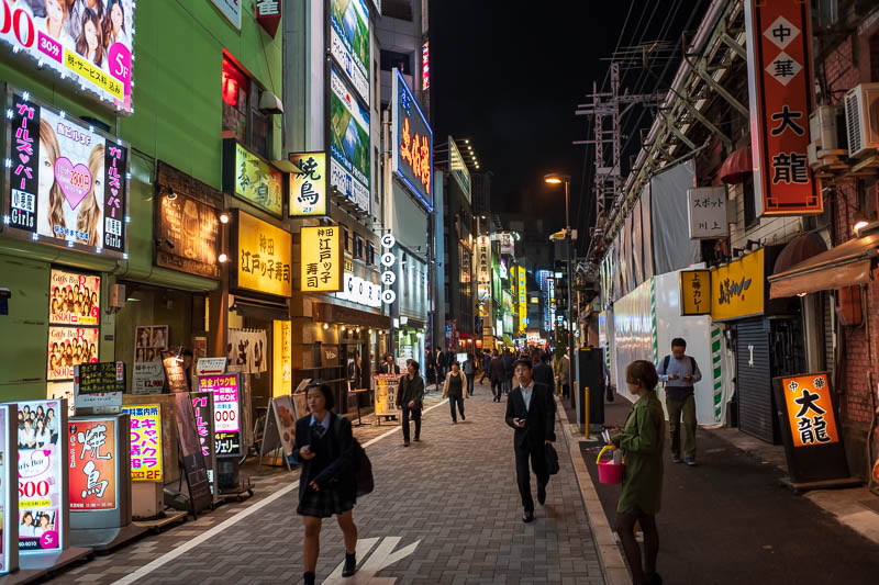 Japan-Tokyo-Akihabara-Ramen - Kanda is also quite a bright colorful place at night. A few junior wannabe Yakuza with the head sets and black gloves hanging around.