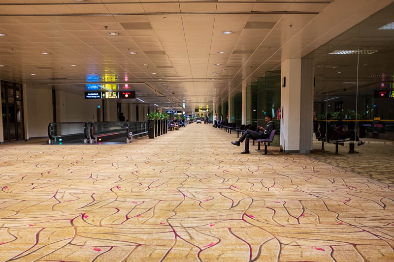 Melbourne-Singapore - Part of my epic 10km walk around Singapore airport. A sea of carpet.