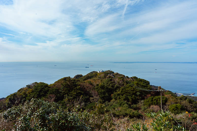 Japan-Chiba-Hiking-Mount Nokogiri - You can however see across to the other side of Tokyo bay, and check out a heap of ships. The white building is the top station of the ropeway for laz