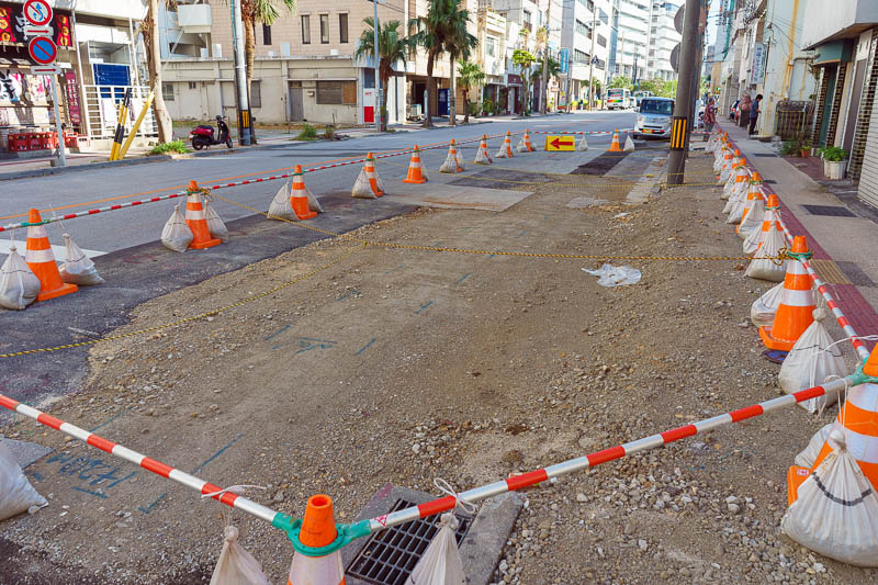 Japan-Okinawa-Naha-Navy - I was amused that not only have the orange cones and barriers been erected around these road works, but some rope has been strung across the area as w