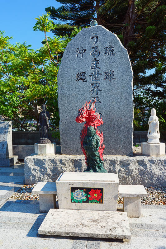 Japan-Okinawa-Naha-Navy - I always enjoy the colorful anime characters decorating graves in shrines.