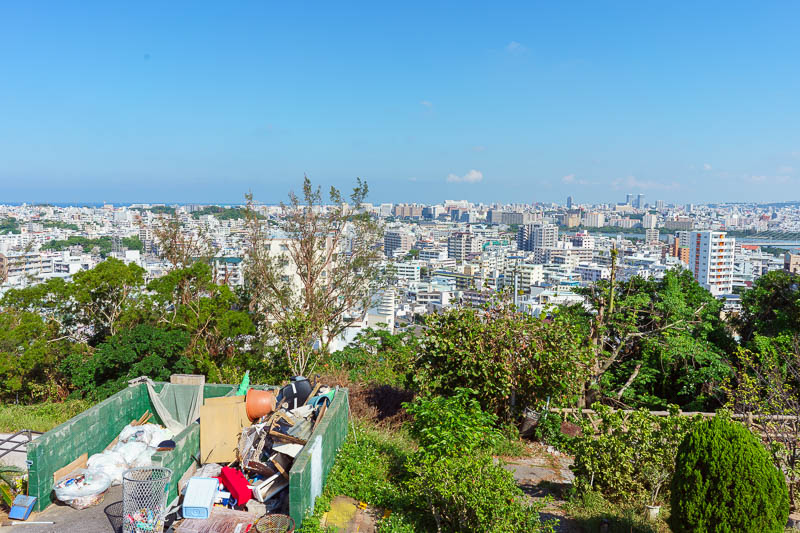 Japan-Okinawa-Naha-Navy - Here is a view of a small rubbish dump on the grounds of the old castle with the main part of the city behind it. That rubbish is visible from the vie